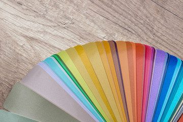 Striped colour sampler on wooden desk background