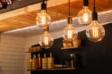 Decorative antique LED tungsten light bulbs hanging on ceiling.