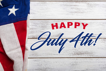 United states flag on white, weathered clapboard background with july 4th greeting