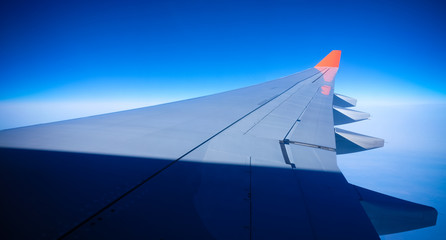 Close up Airplane window with airplane wing