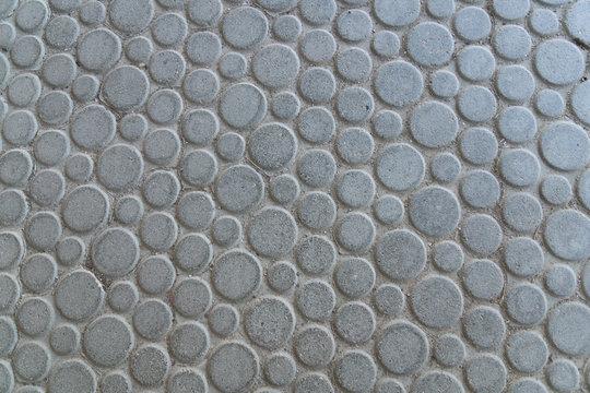 round large gray stone plates laid on the floor - macro