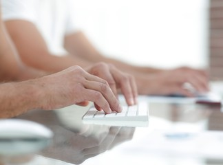 close-up of hand typing text on computer keyboard.