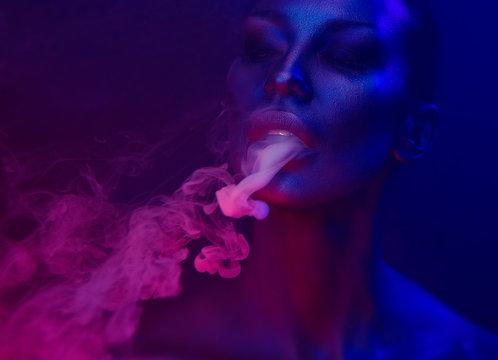 Vape Party, Nightlife. Beautiful Sexy Woman smoking