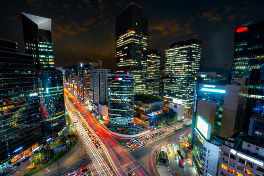 Night scene of light trails traffic speeds through an intersection in Gangnam center business district of Seoul at Seoul city, South Korea.