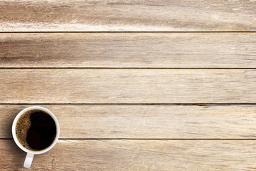 Cup of coffee on a office desk or wood table background.