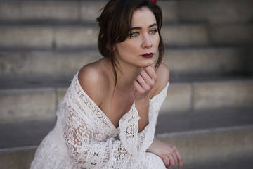 Model in elegant lace dress looking away