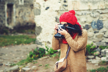 girl traveler with retro camera in old town