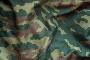 Military uniform pattern with blur effect.