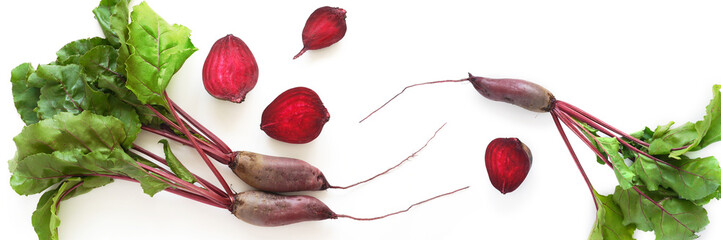 Fototapete - Composition of fresh beets with tops and beets in a cut isolated on a white background. Healthy food. Top view, flat lay.