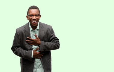 African black man wearing jacket confident and happy with a big natural smile laughing