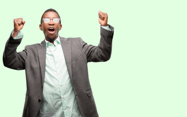 African black man wearing jacket happy and excited celebrating victory expressing big success, power, energy and positive emotions. Celebrates new job joyful