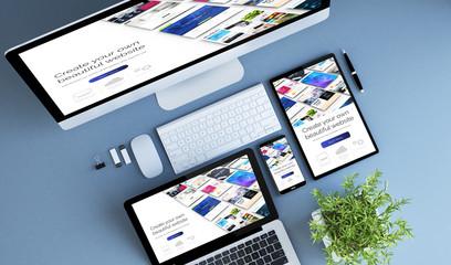 Fototapeta top view blue devices website builder obraz