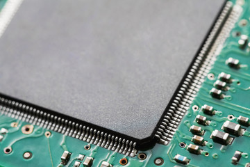 Circuit board with electronic components. Closeup, selective focus