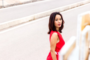 Indonesian asian woman with red long dress fashion