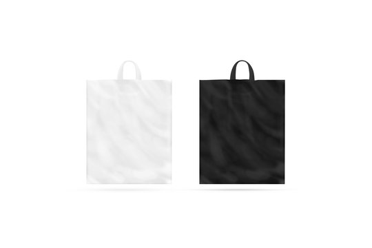 Blank black and white plastic bag with handle mockup isolated, front view, 3d rendering. Empty polyethylene package mock up. Commercial product food packet handle.
