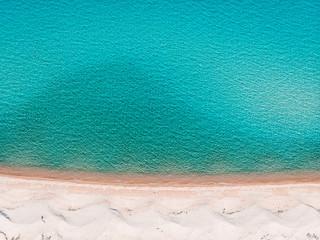 Idyllic sandy beach with azure blue ocean