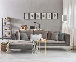 decorative grey details living room with armchair and coffee table.