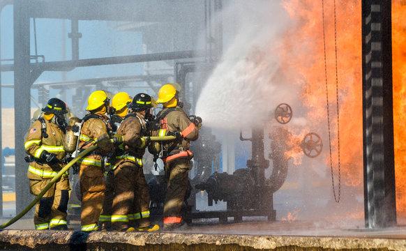Fire fighters battling a blaze at oil pipeline refinery