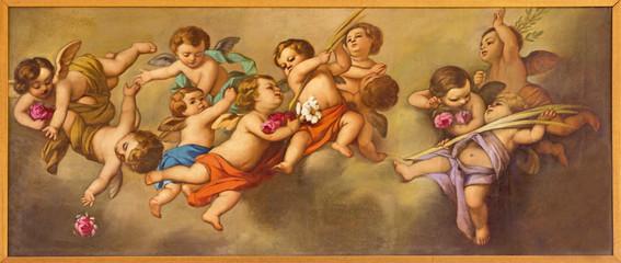REGGIO EMILIA, ITALY - APRIL 12, 2018: The painting of angels in church Chiesa dei Cappuchini by Padre Angelico da Villarotta (1900 - 1987).