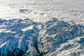 Alps mounrains aerial view from airplane snow and avalanches