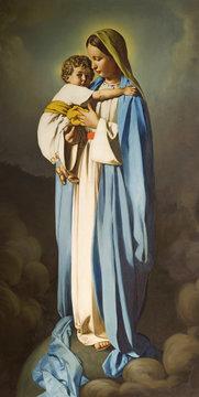 REGGIO EMILIA, ITALY - APRIL 12, 2018: The painting of Madonna with the Child in church Chiesa dei Cappuchini by Padre Angelico da Villarotta (1939).