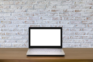 Mock up Laptop with blank screen on wooden table with modern interior background.Mock up business concept.
