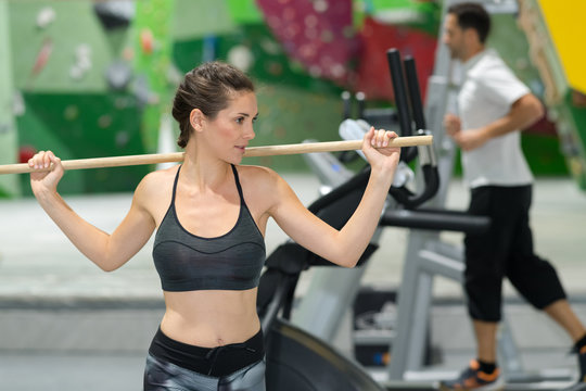 woman holding a fitness stick