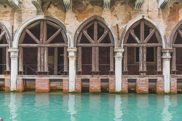 Venice, Veneto, Italy. Old waterfront building along a backstreet canal.