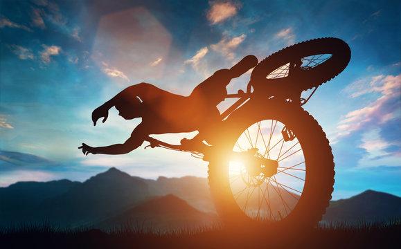 Sportsman doing bike stunts in mountains.