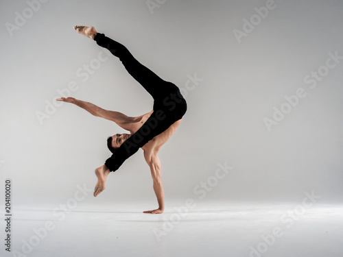 Modern Ballet Dancer Performing Art Jump With Empty Copy Space