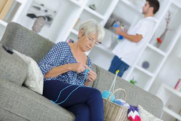 happy senior woman knitting