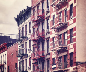 Fire escapes, one of the New York City symbols, color toned picture, USA.