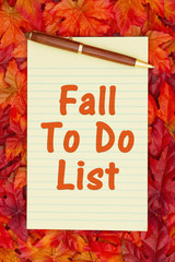 Autumn time To Do List with a yellow notepad and fall leaves