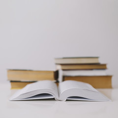 Opened book on white background