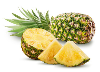 Pineapple fruit whole and cut in half and slice with green leaves