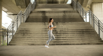 Young woman running in urban enviroment