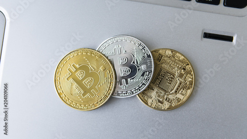 Golden And Silver Bitcoin Coins On A Laptop Digital Crypto Currency Virtual Money