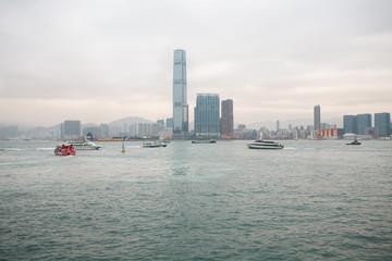 Kowloon skyline and Victoria Harbor boats Hong Kong