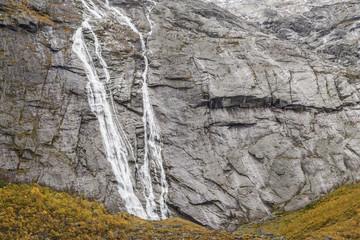 Tjotafossen Waterfall and the Tjotabreen Glacier