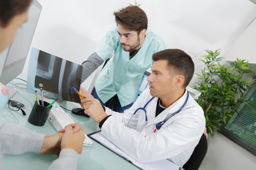 concerned doctors checking patients xray