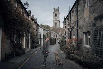 Man and a dog in beautiful street