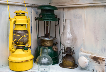 Pile of old vintage and antique oil lamps