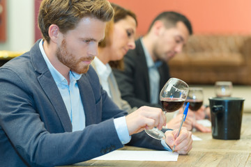 wine expert specialist tasting a glass of wine
