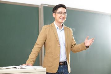 In class the teacher in the classroom