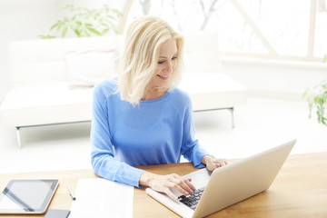 Businesswoman working on laptop from home. Home office.