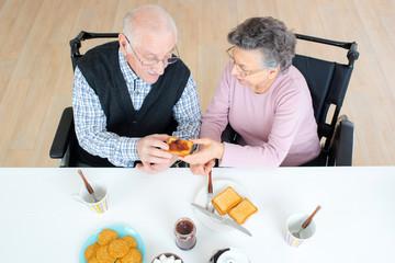 happy senior couple having breakfast