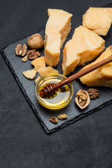 pieces of parmesan or parmigiano cheese and honey