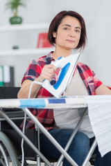 disabled woman ironing at home