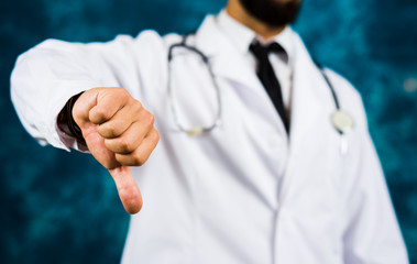 Doctor showing thumbs down close up