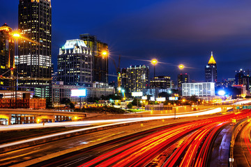 Illuminated Midtown in Atlanta, USA at night. Car traffic